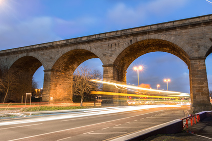 Stone bridge with traffic in Leeds